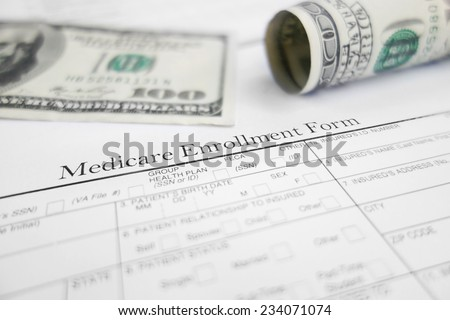 Medicare enrollment form and money