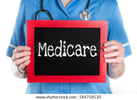 Medicare- Physician with chalkboard on isolated white background - stock photo