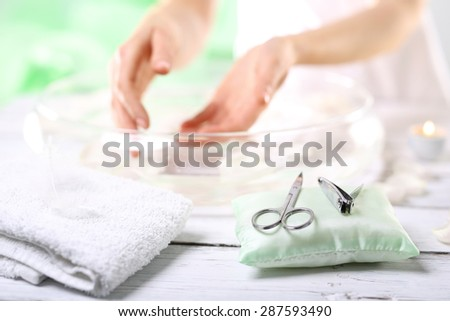 Medicated nail styling. The woman cuts the nails - stock photo