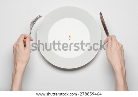 Medications and improper nutrition topic: human hand hold a plate with pill isolated on white background top view - stock photo