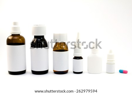 Medications in bottles grouped and isolated on white