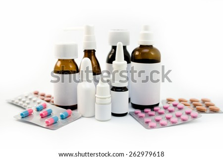 Medications in the bottles groupped and isolated on white - stock photo