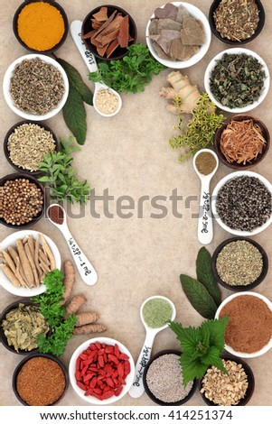 Medicinal herb and spice selection used in alternative medicine forming an abstract background on hemp paper. - stock photo