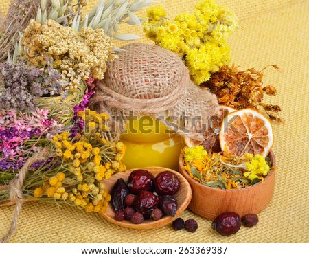 Medicinal herbs with honey, calendula, oats, immortelle flower, tansy herb, wild rose, dried lemon.