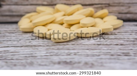 Medicinal pills over rustic wooden background
