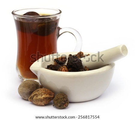 Medicinal Triphala Tea, a combination of ayurvedic fruits, of Indian subcontinent - stock photo