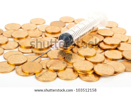 Medicine and coin on white background