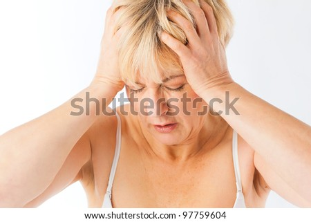 Medicine and disease - a mature woman with headache or migraine