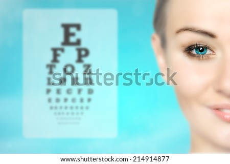 medicine and vision concept - woman and eye chart, future technology