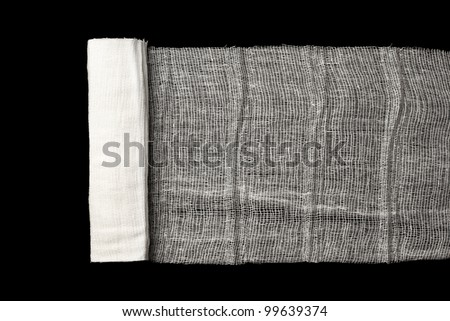 Medicine Bandage isolated on a black background - stock photo