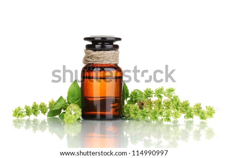medicine bottle and flowers isolated on white