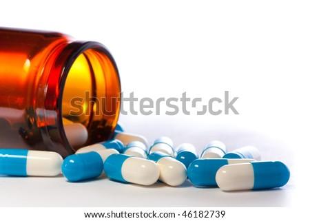 medicine bottle and pills - stock photo