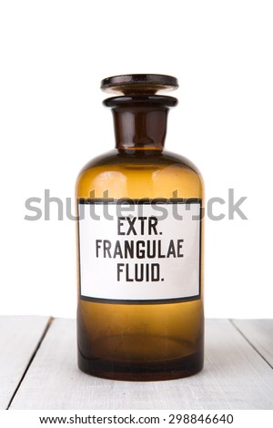 medicine bottle on wooden table isolated on white - stock photo