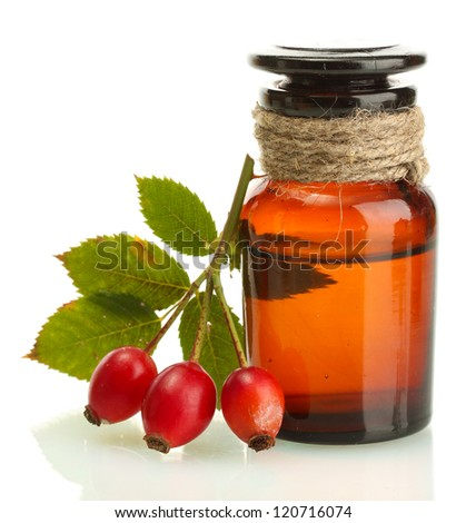 medicine bottle with hip roses, isolated on white - stock photo