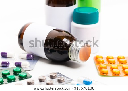 Medicine bottles and pills close up