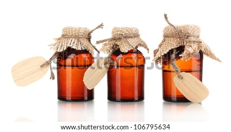 Medicine bottles with blank labels isolated on white - stock photo