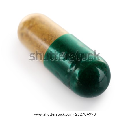 Medicine capsule isolated on white - stock photo