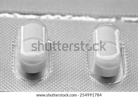 Medicine concepts. Macro picture of capsule pills in the plate - stock photo