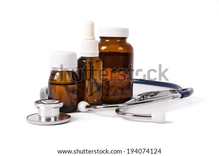 medicine containers with medical instruments on white background