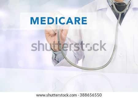 Medicine doctor hand working, Health concept - MEDICARE sign virtual screen - stock photo