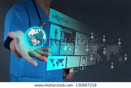 Medicine doctor hand  working with modern computer interface as concept - stock photo