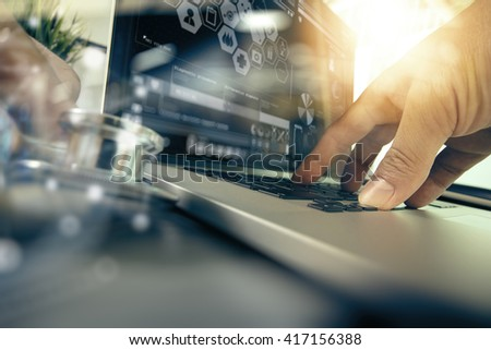 Medicine doctor hand working with modern digital tablet and laptop computer with computer interface as medical network concept - stock photo