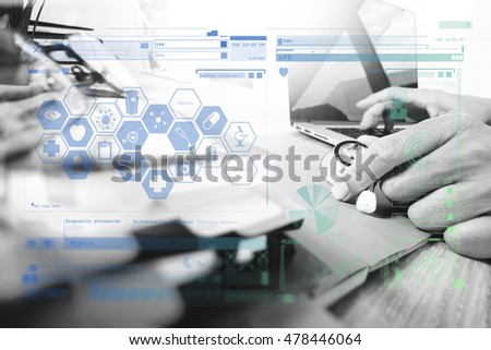 Medicine doctor hand working with modern digital tablet and laptop computer with computer interface as medical network concept. virtual screen , black white