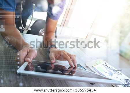 Medicine doctor hand working with modern digital tablet computer interface as medical network concept - stock photo