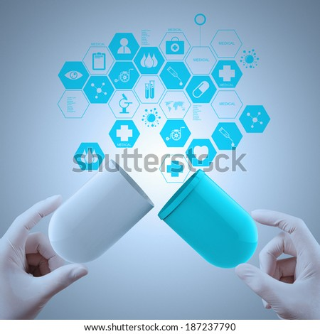 Medicine doctor hands holding capsule medicine as medical concept  - stock photo