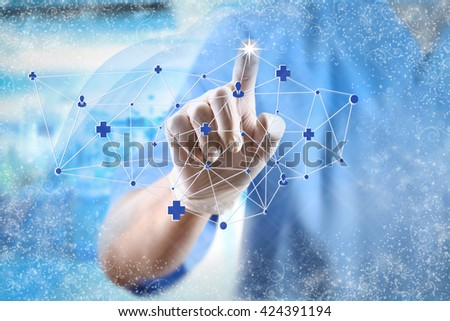 Medicine doctor working with modern computer interface with snow effect - stock photo