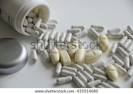 medicine; drug; remedy; medicament; preparation; therapeutic; cure; tablet; pill; pills background, white background