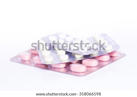 Medicine green and yellow pills or capsules on white background with copy space. Drug prescription for treatment medication. Pharmaceutical medicament, cure in container for health. Antibiotic closeup - stock photo