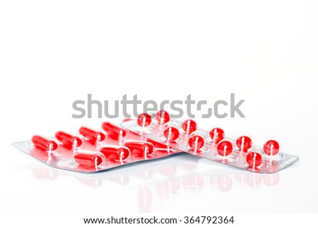 Medicine green and yellow pills or capsules on white background with copy space. Drug prescription for treatment medication. Pharmaceutical medicament, cure in container for health. Antibiotic - stock photo