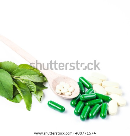Medicine herb. Herbal pills with healthy medical plant. Green leaf, alternative drug. Natural pharmaceutical capsule. Vitamin supplement for care, medication, treatment. - stock photo
