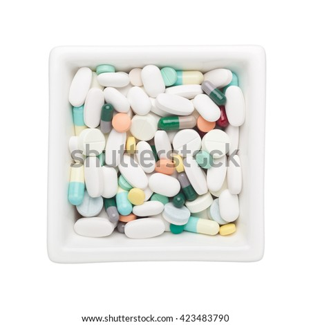 Medicine in a square bowl isolated on white background - stock photo