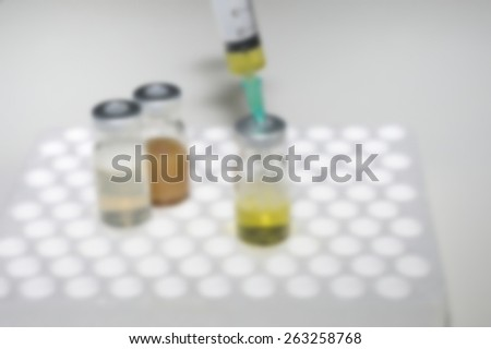 medicine injection laboratory is blurred - stock photo