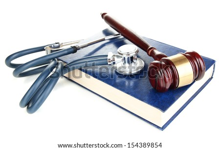 Medicine law concept. Gavel and stethoscope on book isolated on white  - stock photo