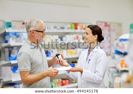 medicine, pharmaceutics, health care and people concept - happy pharmacist giving drug to senior man customer and taking prescription at drugstore