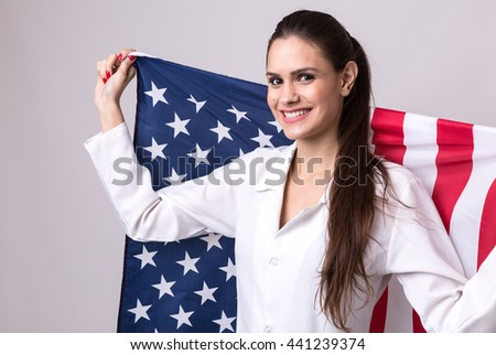 Medicine, pharmacy, healthcare and pharmacology concept, girl holding the USA flag - stock photo