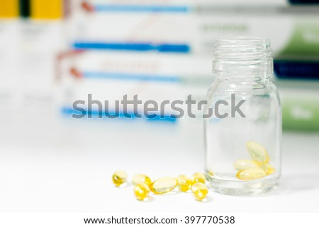 Medicine pills or capsules in bottle on white background. Drug prescription for treatment medication. Pharmaceutical medicament, cure in container for health. Antibiotic, painkiller closeup. - stock photo