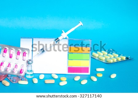 Medicine pills or capsules with syringe on white background. Drug prescription for treatment medication. Pharmaceutical medicament, cure in container for health. Antibiotic, painkiller or narcotic  - stock photo
