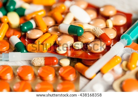 Medicine prescription. Pills and antibiotic in blurred background in close up photo - stock photo