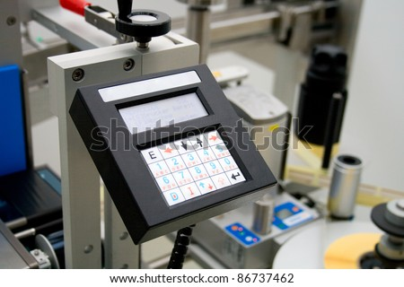 Medicine production in a pharmaceutical industry. Control panel labeling machine. - stock photo