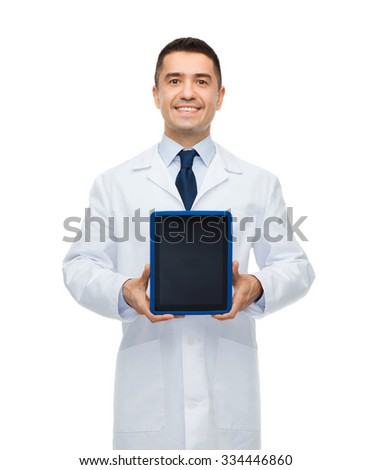 medicine, profession, advertisement and healthcare concept - smiling male doctor showing tablet pc computer blank screen - stock photo