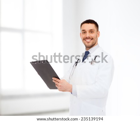 medicine, profession, and healthcare concept - smiling male doctor with clipboard and stethoscope writing prescription over white background - stock photo