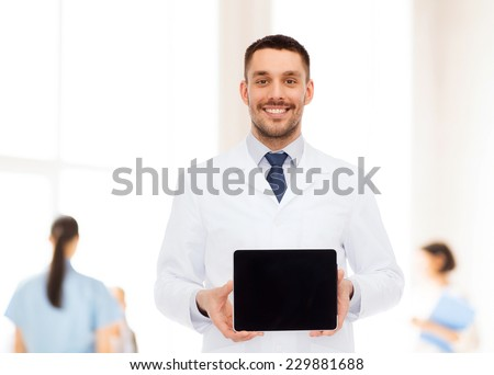 medicine, profession, and healthcare concept - smiling male doctor with tablet pc computer - stock photo
