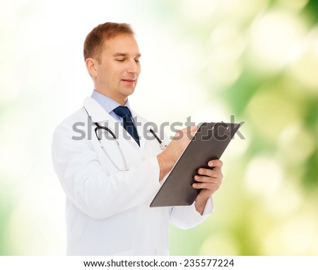 medicine, profession, environment and healthcare concept - smiling male doctor with clipboard and stethoscope writing prescription over natural background - stock photo