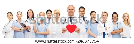 medicine, profession, teamwork and healthcare concept - international group of smiling medics or doctors with clipboard and stethoscopes holding red paper heart shape over white background - stock photo