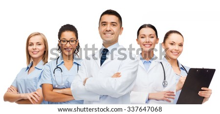 medicine, profession, teamwork and healthcare concept - international group of smiling medics or doctors with clipboard and stethoscopes