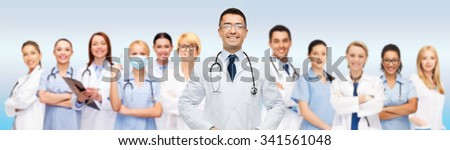 medicine, profession, teamwork and healthcare concept - international group of smiling medics or doctors with clipboard and stethoscopes over gray background